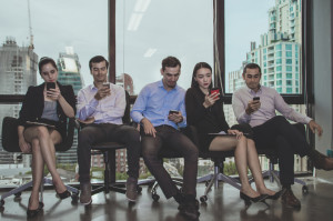Business Concepts. Young business people is playing mobile. Business people are contacting customers.
